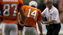 B.C. Lions' quarterback Travis Lulay is helped by athletic therapist Bill Reichelt after rushing for a touchdown during the second half of a CFL football game against the Montreal Alouettes in Vancouver, on Sunday September 15, 2013. (DARRYL DYCK/THE CANADIAN PRESS)