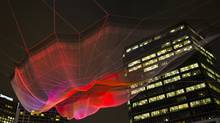 A 230-metre-wide art work installed for the duration of the TED conference near Coal Harbour in Vancouver, on March 12, 2014. The work is by artist Janet Echelman, in conjunction with Google's Creative Lab. (John Lehmann/The Globe and Mail)