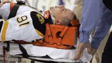 Marc Savard #91 of the Boston Bruins is taken off the ice by medical staff after being injured in the third period against the Pittsburgh Penguins at Mellon Arena on March 7, 2010 in Pittsburgh, Pennsylvania. The Penguins defeated the Bruins 2-1. (Photo by Justin K. Aller/Getty Images) (Justin K. Aller/2010 Getty Images)
