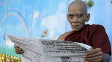 A Buddhist monk reads a newspaper outside the Jivita Dhana Free Hospital for Buddhist Monks on Monday, Nov. 8, 2010, in Yangon, Myanmar. (Khin Maung Win/AP)
