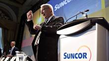 Suncor president and CEO Steve Williams talks to shareholders before his speech during Suncor Energy's annual general meeting in Edmonton on Tuesday, April 29, 2014. (JASON FRANSON/THE CANADIAN PRESS)