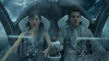 Olga Kurylenko and Tom Cruise in Oblivion. (AP/Universal Pictures)