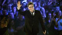 k.d. lang waves to the crowd after receiving a Juno for her Canadian Music Hall of Fame induction on April 21, 2013. (Liam Richards/The Canadian Press)