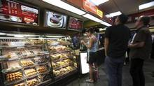 Costumers line up at the Tim Hortons coffee shop inside New York's Penn Station, Monday, July 13, 2009. (Mary Altaffer/AP/Mary Altaffer/AP)