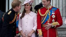 Prince Harry, left, Prince William, right, and Catherine, Duchess of Cambridge, stand on the balcony of Buckingham Palace after the Trooping the Colour ceremony in London on June 15, 2013. (PAUL HACKETT/Reuters)
