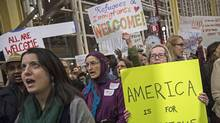 Protesters gather outside of the Ronald Reagan National Airport in Arlington, V.a., to rally against President Donald Trump's executive order curtailing immigration into the country on Feb. 1. (Drew Angerer/Getty Images)