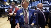 Trader Richard Newman works on the floor of the New York Stock Exchange. The benchmark stock index has set a series of record highs. (Richard Drew/AP)