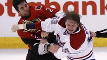 Ottawa Senators' Jared Cowen fights with Montreal Canadiens' Ryan White during the third period of their NHL Eastern Conference quarterfinal (CHRIS WATTIE/REUTERS)