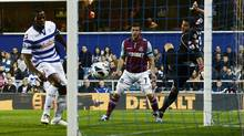 West Ham United's Matt Jarvis (C) scores past Queens Park Rangers goalkeeper Julio Cesar (R) as Stephane Mbia looks on during their English Premier League soccer match at Loftus Road in London October 1, 2012. (DYLAN MARTINEZ/Reuters)