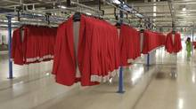 A woman works at the Zara factory at the headquarters of Inditex group in Arteixo, northern Spain, in this file photo. (MIGUEL VIDAL/REUTERS)