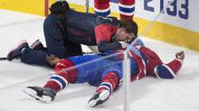 Montreal Canadiens' P.K. Subban is tended to by medical staff during third period NHL hockey action against the Buffalo Sabres in Montreal, Thursday, March 10, 2016. (Graham Hughes/THE CANADIAN PRESS)