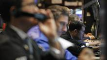 Traders work on the floor of the New York Stock Exchange, August 22, 2012.  (BRENDAN MCDERMID/REUTERS)