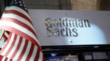 A view of the Goldman Sachs stall on the floor of the New York Stock Exchange July 16, 2013. (© Brendan McDermid / Reuters)