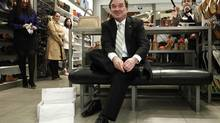 Continuing the tradition of buying new shoes before delivering a budget, Mr. Flaherty gets ready for a budget in March, 2012, that will announce the end of the penny. (CHRIS WATTIE/REUTERS)