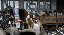 A pro-Russia protester shouts slogans at a barricade outside a regional government building in Donetsk, in eastern Ukraine, April 15, 2014. (MARKO DJURICA/REUTERS)