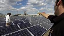 In this file photo, members of the press tour the solar photovoltaic system at Exhibition Place in Toronto, Ont. Solar panels are a problem for firefighters because they are always generating power. (Deborah Baic/The Globe and Mail)