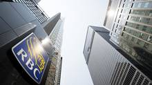 A logo on Royal Bank Plaza is pictured on Bay Street in Toronto on Friday, July 25, 2014. (DARREN CALABRESE FOR THE GLOBE AND MAIL)