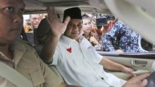 Indonesian losing presidential candidate Prabowo Subianto waves at photographers as he leaves after a hearing on the dispute over the results of the July 9 presidential election, at the Constitutional Court in Jakarta, Indonesia, Wednesday, Aug. 6, 2014. (Tatan Syuflana/AP)
