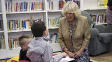 The Duchess of Cornwall chats with students reading in the library while touring the Hazen White-St Francis School in Saint John, N.B., on Monday, May 21, 2012. The royal couple are on a four-day visit to Canada to mark the Queen's Diamond Jubilee. (Paul Chiasson/The Canadian Press/Paul Chiasson/The Canadian Press)
