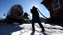 Mike Foster, an employee at Van Etten Oil Company in Monticello, N.Y., returns a filling hose to his propane truck on Jan. 23, 2014. (JOHN DESANTO/ASSOCIATED PRESS)