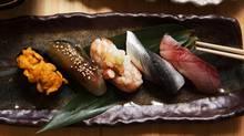 A nigiri sushi set with uni, shime saba with kelp and sesame, akaebi with sweet shrimp paste, kohada and buri is served at Shoushin. (JENNIFER ROBERTS FOR THE GLOBE AND MAIL)
