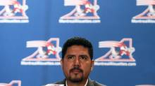Montreal Alouettes quarterback Anthony Calvillo looks on as he announces his retirement from CFL football in Montreal, January 21, 2014. (CHRISTINNE MUSCHI/REUTERS)