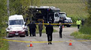 The OPP set up a command centre at a crime scene several hundred metres west of near Mountainview Rd and Beechgrove Sideroads, where human remains were found in a wooded area southeast of Orangeville, August 5, 2010. The remains are believed to be those of Sonia Varaschin who was murdered in her Orangeville apartment 6 days ago. (J.P. Moczulski/The Globe and Mail)
