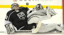 Los Angeles Kings goalie Jonathan Quick stops a shot during the overtime period of their NHL hockey game against the Calgary Flames, Thursday, Jan. 19, 2012, in Los Angeles. The Flames won 2-1 in an overtime shootout. (Mark J. Terrill/AP)