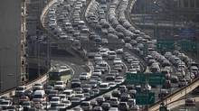 Heavy traffic on a highway during the morning rush hours in Shanghai last year. (Carlos Barria/Reuters)