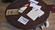 Both Muslim and Christian religious material is seen on a table of the apartment rented to suspects John Nuttall and Amanda Korody in Surrey, British Columbia July 3, 2013. Both suspects were arrested by Royal Canadian Mounted Police after they allegedly planned to place bombs on the grounds of the British Columbia Legislature in Victoria on Canada Day July 1. REUTERS/Andy Clark (CANADA - Tags: CRIME LAW) (ANDY CLARK/REUTERS)