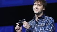 PlayStation 4's lead system architect Mark Cerny holds a gaming control device during the unveiling of the device in New York Feb. 20, 2013. (BRENDAN MCDERMID/REUTERS)