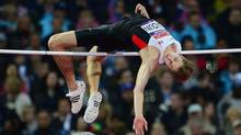 Canada's Derek Drouin jumps to a bronze medal in the men's high jump final at the Olympic Stadium during the Summer Olympics in London on Tuesday, August 7, 2012. (Sean Kilpatrick/THE CANADIAN PRESS)