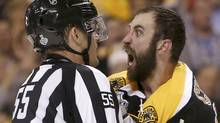 NHL linesman Shane Heyer gets an earful from Boston Bruins defenseman Zdeno Chara as he breaks up a third period scuffle with Chicago Blackhawks left wing Bryan Bickell (not pictured) in Game 3 of their NHL Stanley Cup Finals hockey series in Boston. (Reuters)