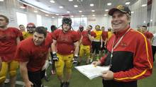 Guelph head coach Stu Lang, a former star wide receiver with Queen's University and the Edmonton Eskimos, is donating $10-million to the team that eliminated his Gryphons in 2013. (J.P. MOCZULSKI FOR THE GLOBE AND MAIL)