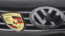 Volkswagen acquiring remaining half of Porsche's auto business for €4.5-billion (Matthias Rietschel/AP)