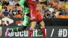 Toronto FC defender Nick Hagglund (17) and DC United goalie Bill Hamid (28) battle for the ball during the second half at Robert F. Kennedy Memorial. DC United won 3-0. (Brad Mills/USA Today Sports)