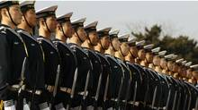 Members of the Chinese Navy honour guard wait for U.S. Secretary of Defense Robert Gates during his visit to Beijing this week. (Larry Downing-Pool/Getty Images/Larry Downing-Pool/Getty Images)
