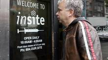Marc Townsend, manager of the Portland Hotel Society, enters Insite, Canada's only safe-injection site for intravenous drug users, in Vancouver in 2007. (Richard Lam/The Canadian Press)