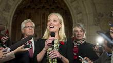 Minister of Environment and Climate Change Catherine McKenna speaks to reporters in the foyer on Parliament Hill after being sworn in earlier in the day, on Nov. 4, 2015. (Justin Tang/THE CANADIAN PRESS)