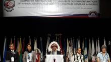 A panel of speakers stand as the opening ceremonies conclude during The Assembly of First Nations Annual General Assembly in Toronto on July 17, 2012. (Michelle Siu/The Canadian Press)