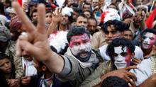 A man flashes the V sign as he attends a rally to mark two years of the military intervention by the Saudi-led coalition, in Sanaa, Yemen, on March 26, 2017. (KHALED ABDULLAH/REUTERS)
