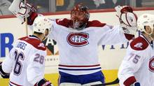 Montreal Canadiens goalie Jaroslav Halak raises his arms as he hugs teammate Josh Gorges (L) after defeating the Pittsburgh Penguins following Game 7 of their NHL Eastern Conference semi-final hockey series in Pittsburgh, Pennsylvania May 12, 2010. (DAVID DENOMA/REUTERS)