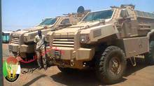 This photo from a now-closed Facebook page of the Sudan armed forces shows vehicles that researchers say were built by Streit Security Vehicles and were deployed by the Sudan military in 2013. (Sudanese Armed Forces)