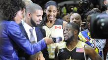 USA celebrity head coach Kevin Hart and Canada celebrity head coach Drake are interviewed after the All-Star celebrity basketball game at Ricoh Coliseum in Toronto on Friday, Feb. 12, 2016. (Peter Llewellyn/USA Today Sports)