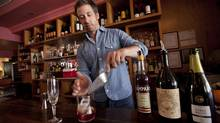 Dave Mitton of THR & Co. and the Harbord Room mixes a Negroni Sbagliato, made with Campari, sweet vermouth and cava. (Deborah Baic/The Globe and Mail)