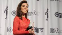 Feist poses with the Juno award for the Artist of the Year during the Juno Awards ceremony in Ottawa, Sunday April 1, 2012. (Sean Kilpatrick/CP)