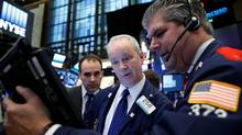 Traders work on the floor of the New York Stock Exchange (NYSE) on Nov. 10. (Brendan McDermid/Reuters)