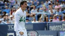 Milos Raonic celebrates after he beat fellow Canadian Vasek Pospisil in the men's singles final match at the Citi Open tennis tournament, Sunday, Aug. 3, 2014, in Washington. Raonic won 6-1, 6-4. (AP)
