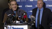 Toronto Deputy Mayor Norm Kelly speaks to the media as Mayor Rob Ford stands in the background at a news conference after an ice storm left over 250,000 customers across the city without power on Sunday, December 22, 2013. (Chris Young/THE CANADIAN PRESS)
