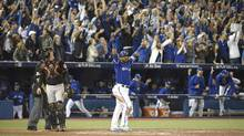 Edwin Encarnacion hit a three-run home run in the bottom of the 11th to give the Blue Jays a 5-2 win. Toronto will play Texas in the ALDS. (Fred Lum/The Globe and Mail)